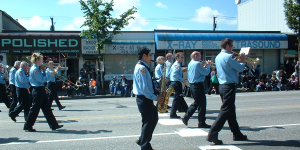Band marching in Burnaby's 2010 Hats Off Day Parade