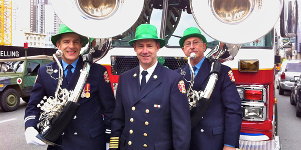 Fire Chief John McKearney, with Dan and Wayne sporting the band's new tubas, standing in front of Ladder 7, preparing for the 2012 St. Patrick's Day Parade, Vancouver.