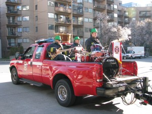 Part of the band in the back of a fire department pickup for the St. Patrick's Day Parade