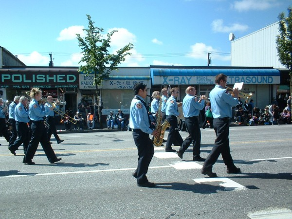 The Vancouver Fire and Rescue Services Band marching in the 2010 Burnaby Hats Off Day Parade down Hastings Street